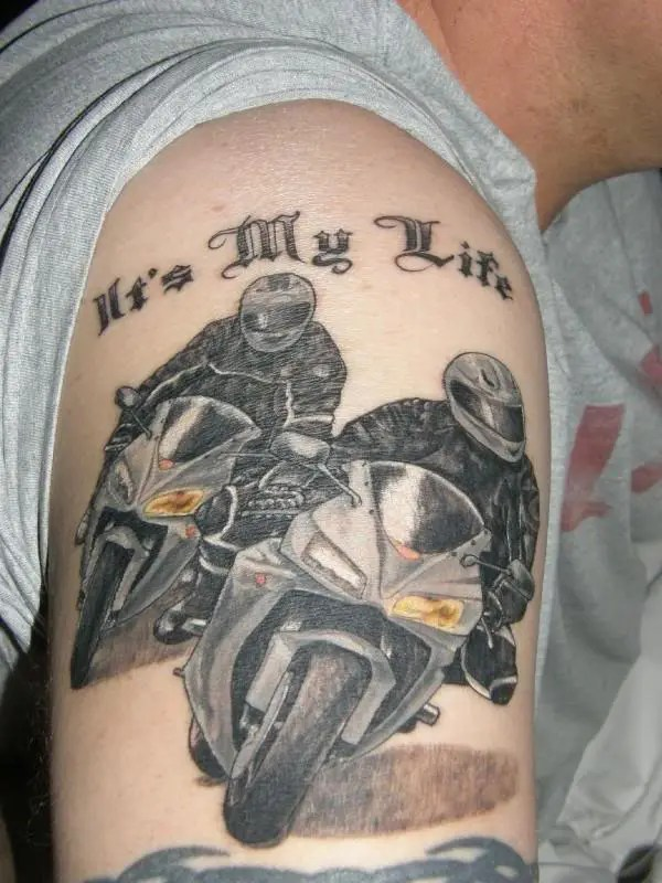 Superb Yellow And Black Color Ink Racing Bike Riders Tattoo Design On Shoulder For Boys