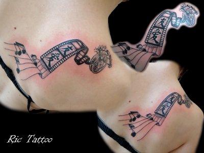 Sweet Black And Red Color Ink Film Reel Tattoo On Back Shoulder For Girls