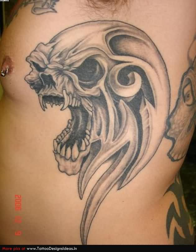Sweet Black Color Ink Crawling Alien Skull Tattoo On Rib Side For Boys
