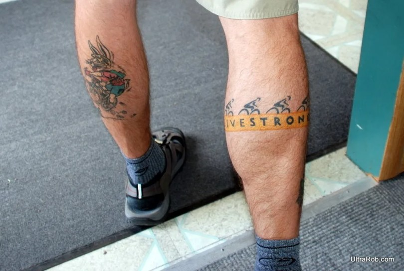 Terrific Blue Black And Red Color Ink Livestrong Cycle Tattoo Design On Back Legs For Boys