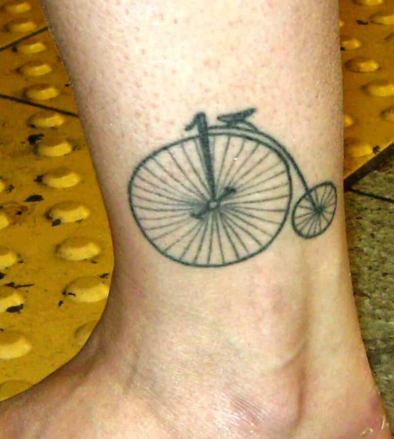 Traditional Black Color Ink Bicycle Tattoo On Ankle For Boys