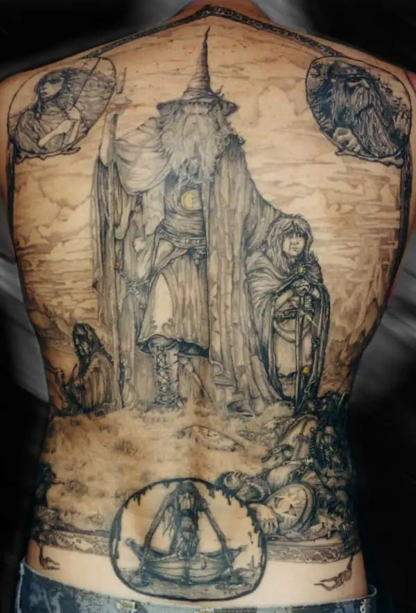 Tremendous Wizard Tattoo On Back With Black Ink For Grils