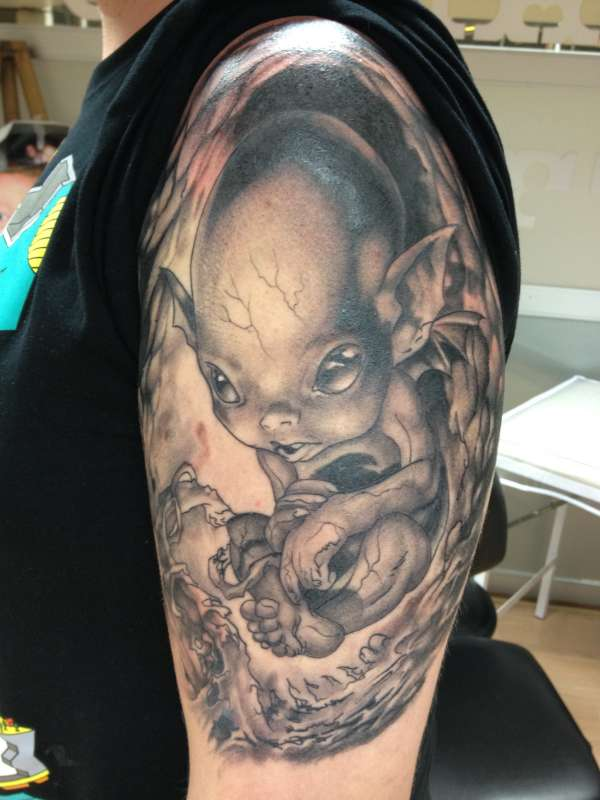 Trendy Black Color Ink Alien Baby Tattoo On Muscles For Boys