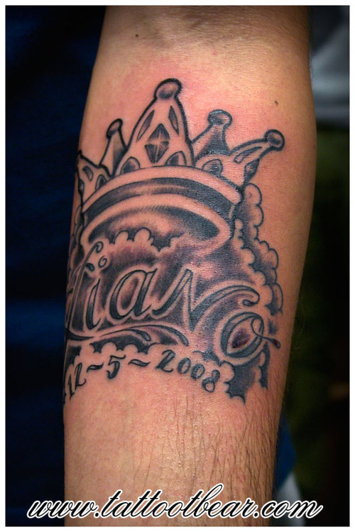 Ultimate Blue Color Ink Crown Tattoo On Arm For Boys