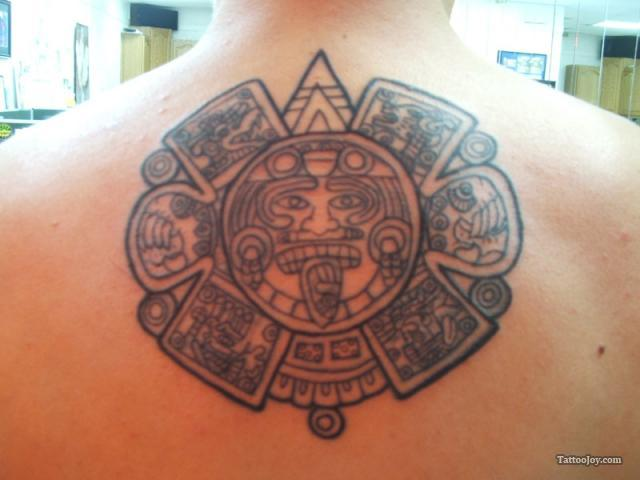 Unique Black Color Ink Aztec History Tattoo On Back For Boys