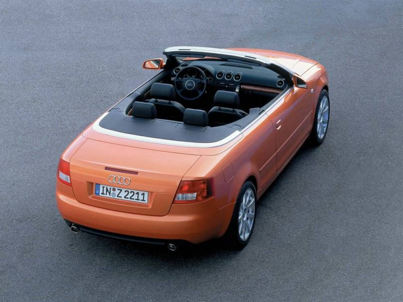 Upper side view of beautiful orange colour Audi A4 Cabriolet car