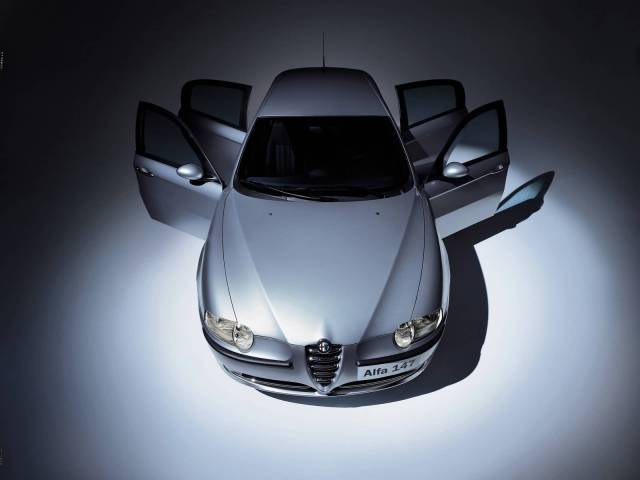 Very fast silver Alfa Romeo 147 Car upper side view