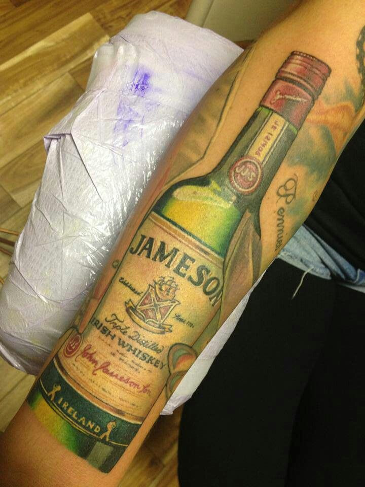 Weird Red Green And Yellow Color Ink Real Looking Green Whiskey Bottle Tattoo On Arm For Girls