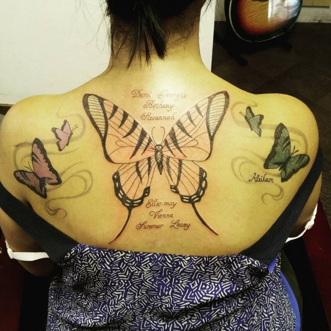 attractive back tattoo with black ink for man and woman