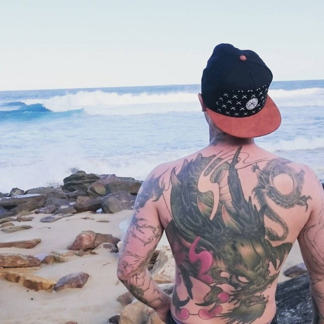 cutest back tattoo with black ink for man and woman
