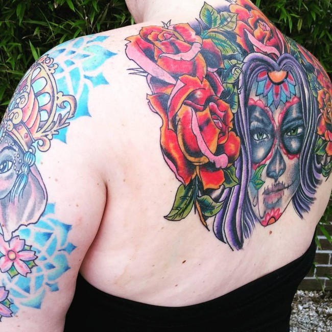 most lovely back tattoo with colorful ink for man and woman
