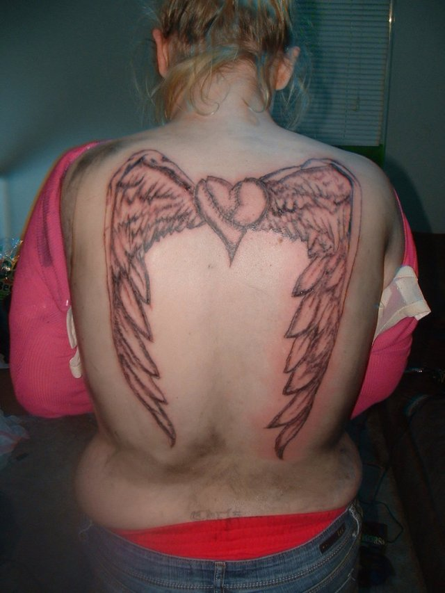 Adorable Brown Ink Heart Angel Wings Tattoo On Back For Girls