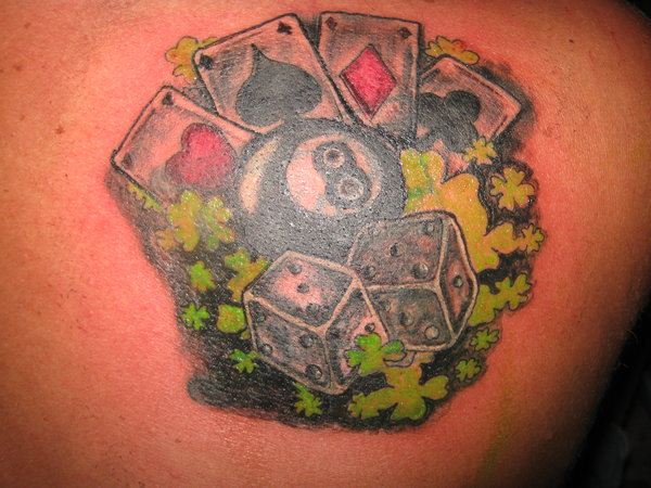 Adorable Gambling Tattoo Picture On Back For Girls