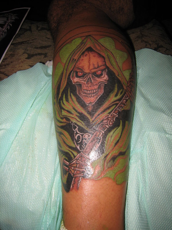 Amazing Grim Reaper Tattoo Picture On The Arm For Boys