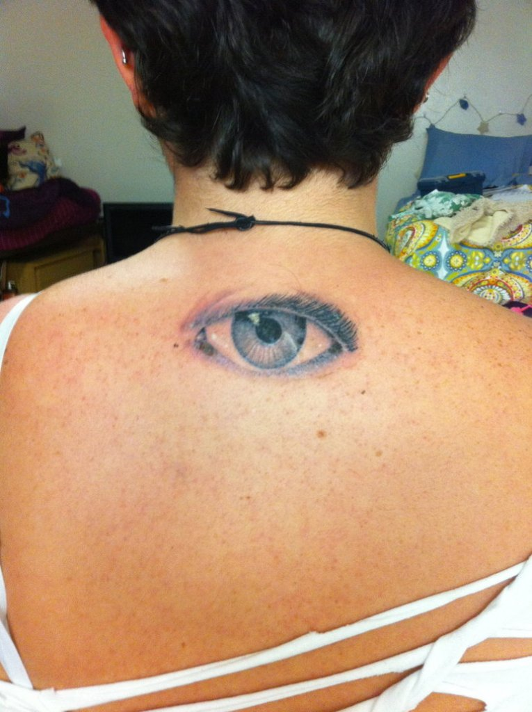 Attractive Eye Tattoo On Upper Back For Girls