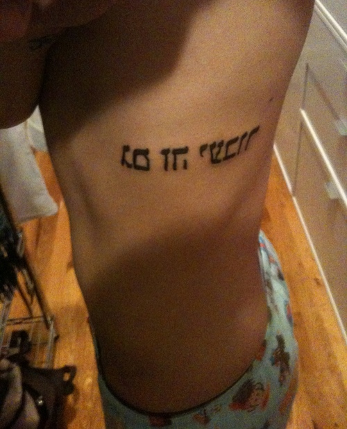 Awesome Hebrew Tattoo Design On Ribs For Boys