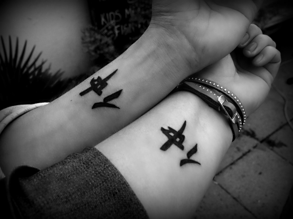 Best Ever Chinese Friends Tattoo On Wrists For Boys