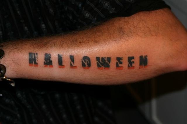 Cool Halloween Lettering Tattoo On Arm For Boys