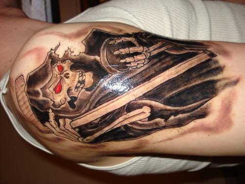 Crazy Grim Reaper Tattoo On Shoulder For Boys