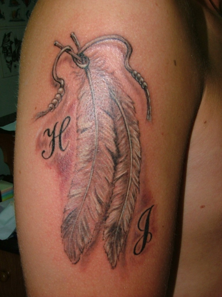 Custom Feathers Tattoo On Biceps For Girls