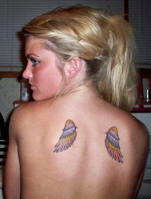 Cute Feminine Wings Tattoo On Back For Girls