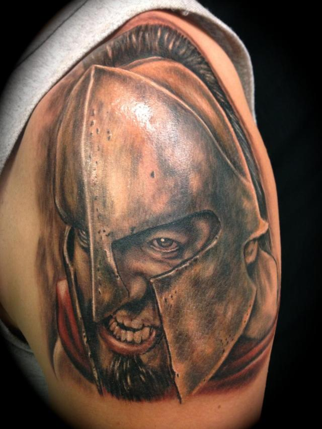 Cute Spartan Head In Helmet Tattoo On Shoulder For Boys