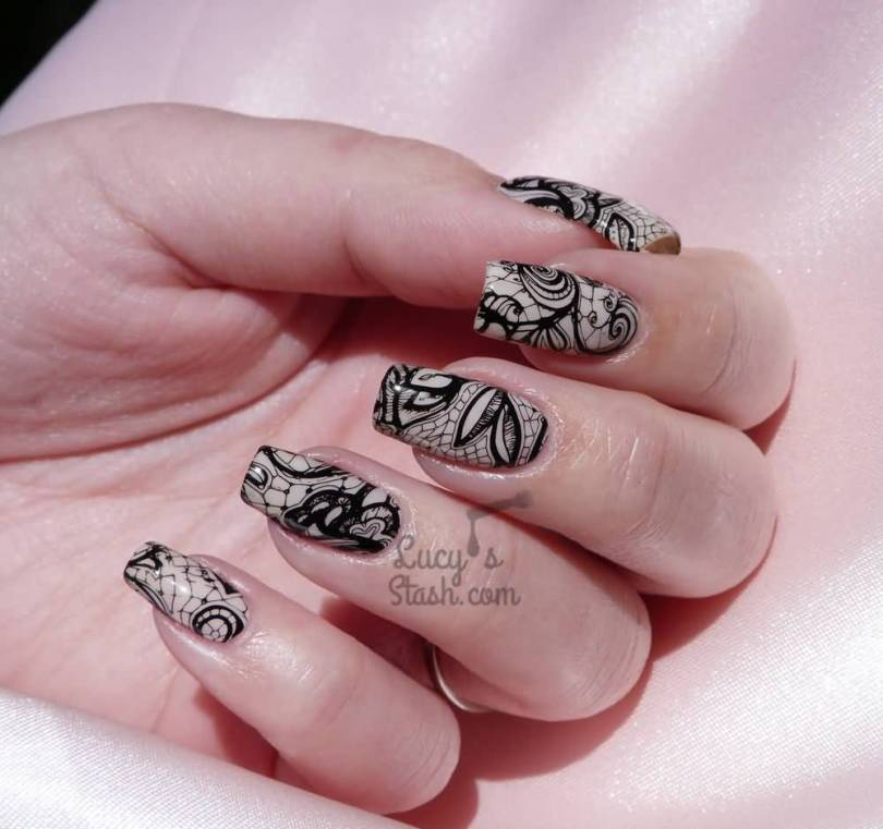 Dashing Black And Beige Nail Art With Flower Design