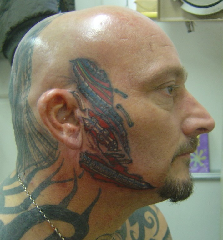 Extremely Bio Mechanical Face Tattoo Design For Boys