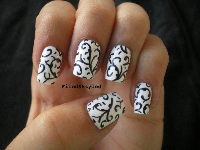 Eye Catching Black And White Nails Of ropes