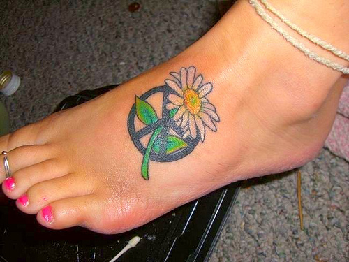 Fabulous Hippie Peace Sign Tattoo On Foot For Girls