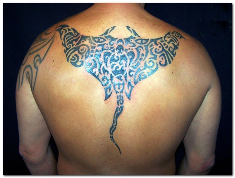 Fabulous Artistic Hawaiian Tribal Tattoo On Upper Back For Boys