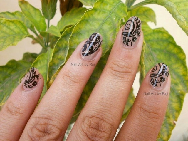 Fabulous Black And Beige Nail Art With Flower And Plant Design