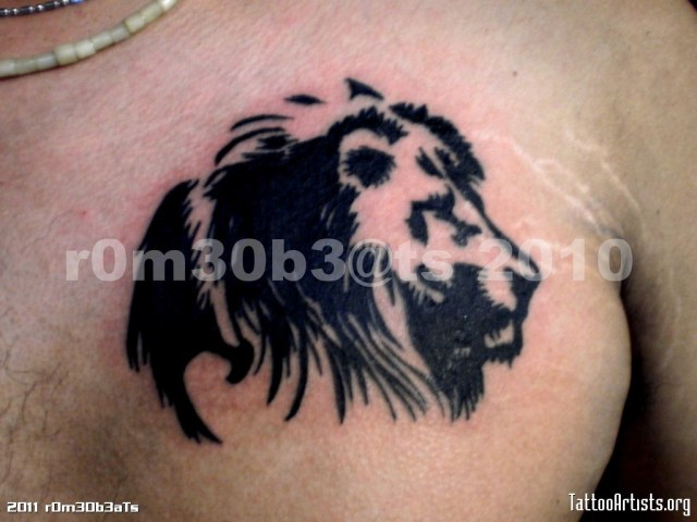 Fabulous Tribal Lion Head Tattoo On Chest For Boys