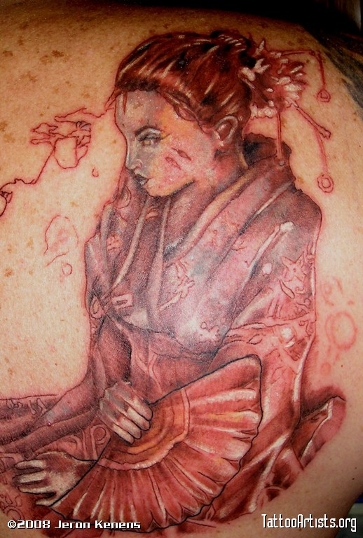 Famous Geisha Comic Style Tattoo On Back Shoulder For Boys