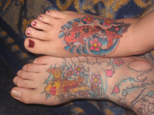 Great Fishes Tattoo Design On Feet For Couples For Girls