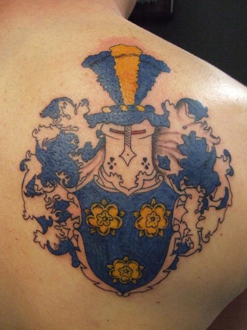 Horrible Family Crest Tattoo On Shoulder Back For Boys