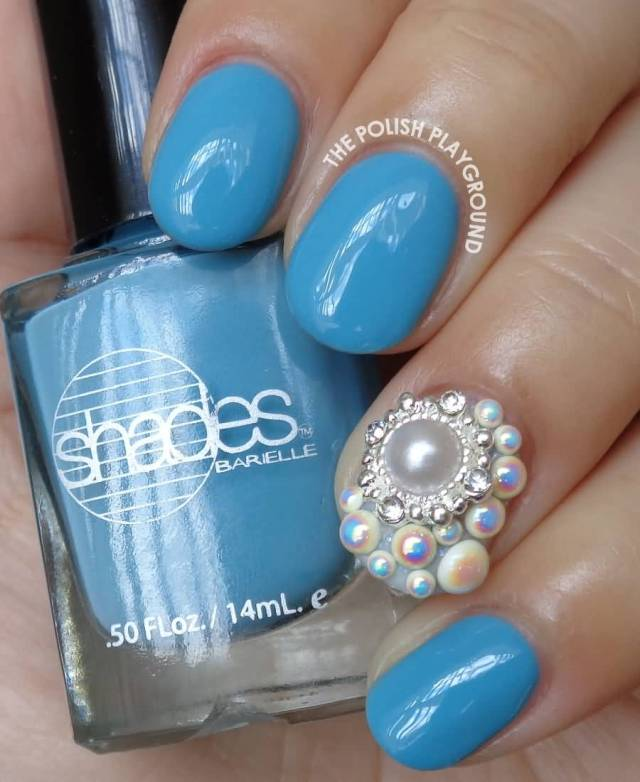 Incredible Blue Paint With Pearls Accent Nail Design