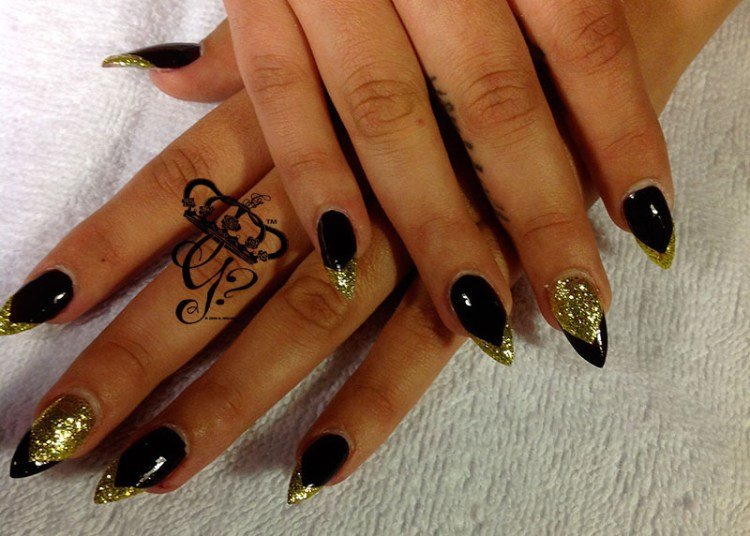 Incredible Stiletto Nails With Golden Nail Paint