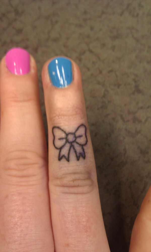 Latest Bow Finger Tattoo For Women