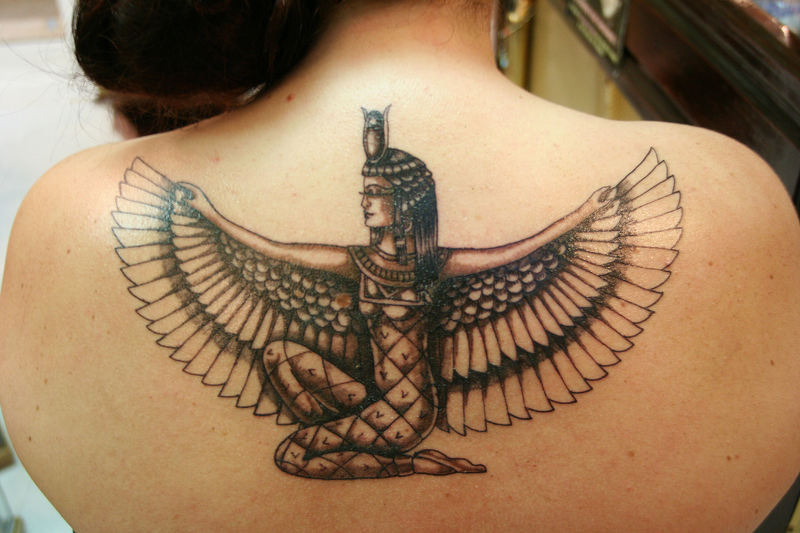 Marvel Egyptian Tattoo Design On Upper Back For Women