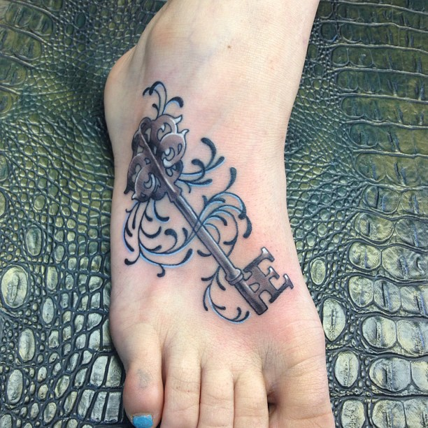 Marvelous Key Foot Tattoo For Girls