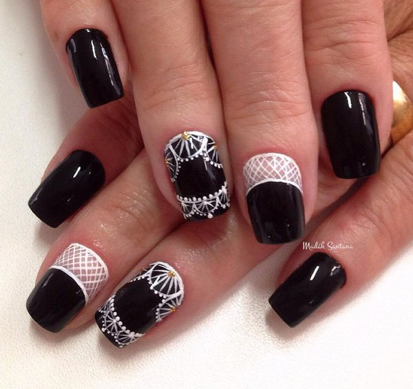 Most Unique Black Nail Art Design With White Paint Designs