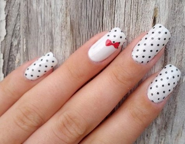 Most dashing Black And White Polka Dot Nail Art With Red Color Bow