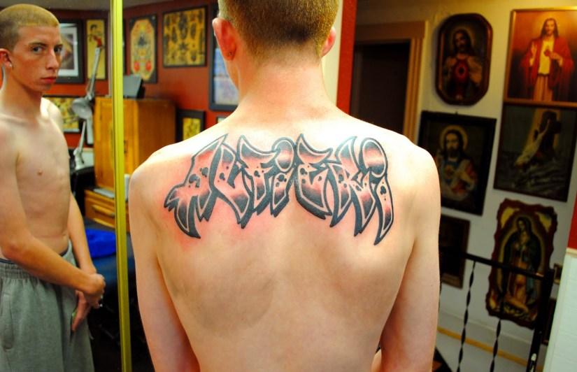 Motivational Alfieri Graffiti Tattoo On Upper Back For Boys