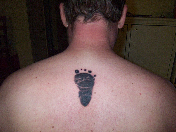 Motivational Footprint Tattoo On Upperback For Boys