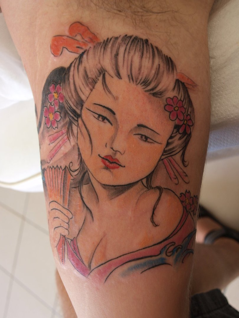 Motivational Geisha Tattoo On Muscles For Boys
