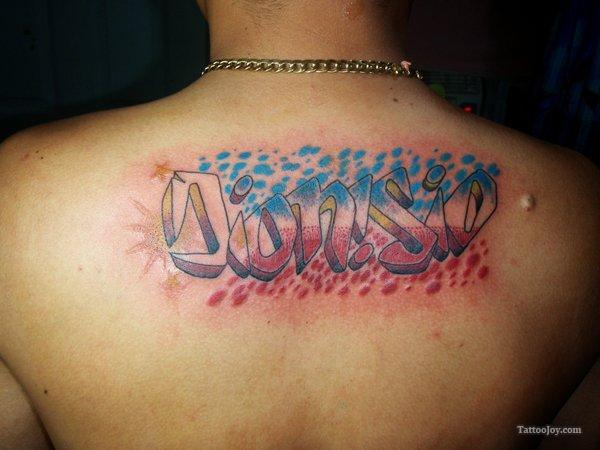 Out Standing Graffiti Letters Tattoo On Upper Back For Boys