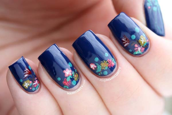 Phenomenal Blue Nail Art With Flower Design