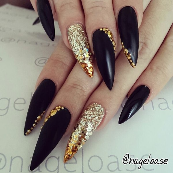 Sensational Stiletto Nails With Black And Golden Design
