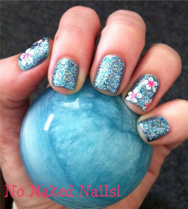 Sparkling Blue Paint With Flower Accent Nail Art